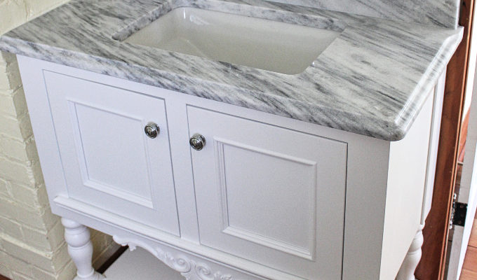 custom-white-vanity-cabinet-marble-countertop